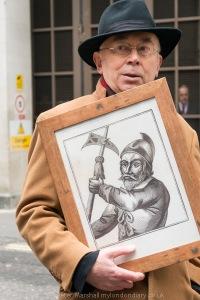 Ian Bone displays the portrait of Thomas Venner