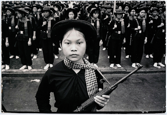 """A brigade of Vietcong women soldiers in gala-uniform stand in formation with Type 56 rifles during a victory parade. Vietnam, no date / Bollinger."" (C) Black Star Publishing Co. Inc."