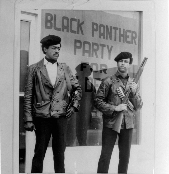 Co founders of the Black Panther Party - national chairman Bobby Seale, left, wearing a Colt .45, and Huey Newton, right, defense minister with a bandoleer and shotgun are shown in Oakland, Calif. - Photograohy: AP Photo/San Francisco Examiner